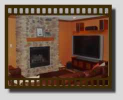 Finished basement with a fireplace.